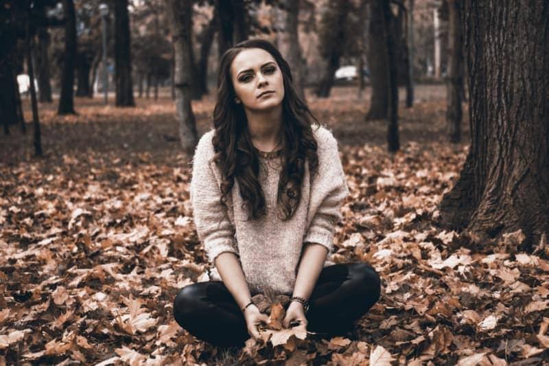 girl depressed in woods