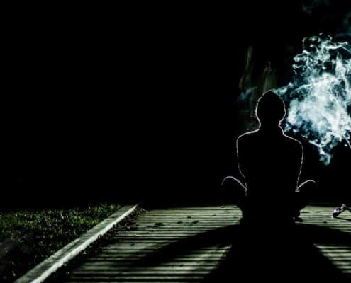 A person smoking some kind of drug