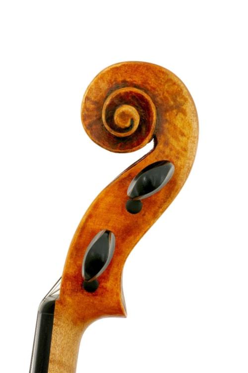 Side view of scroll of Guarneri model violin made in 2019