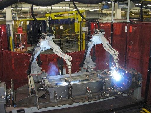 Two robots MIG welding a part
