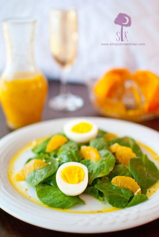 Fresh spinach salad with hardboiled eggs and oranges
