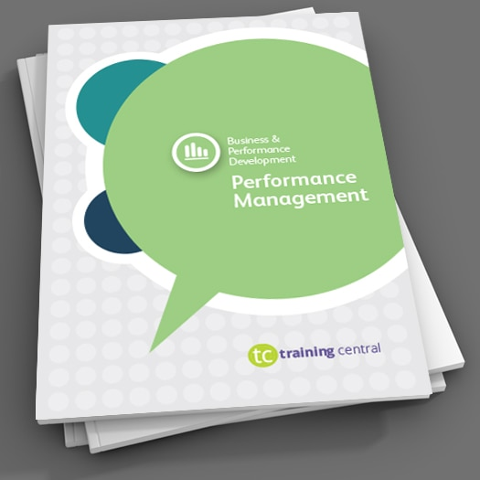 Image shows a close up of the cover of the workbook for Training Central's Performance Management training materials.