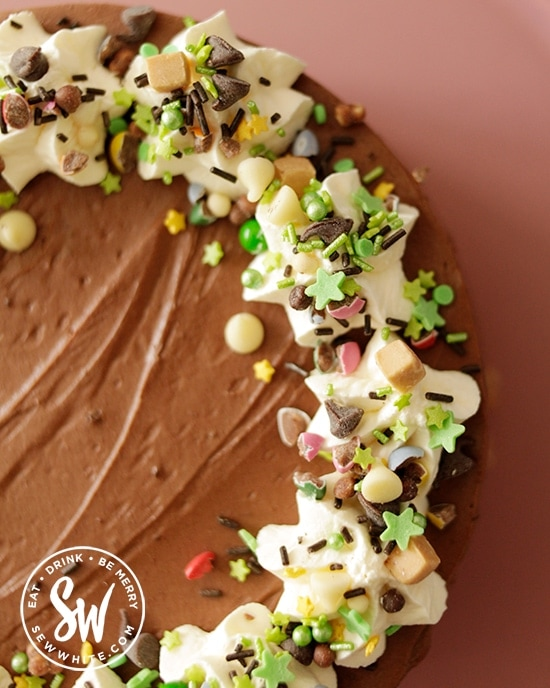 Close up of the Ireland green sprinkles on top of the Guinness Chocolate cheesecake perfect for St Patrick's Day.