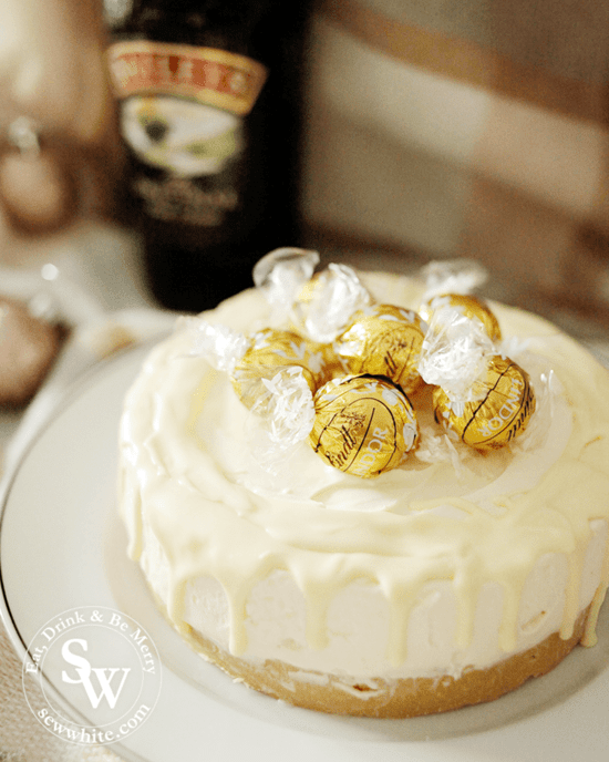Golden Lindt truffles on a cheesecake.