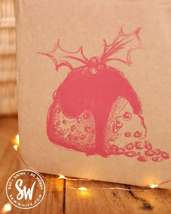 Figgy's pudding box with Christmas pudding illustration on the Sew White Eat gift guide.