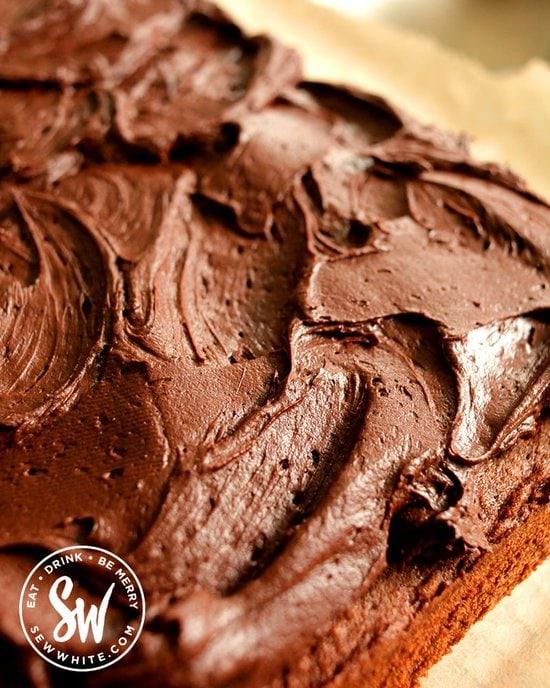 Close up of chocolate cream cheese buttercream on the ultimate chocolate traybake