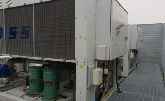 Glycol chiller maintenance of two white chillers with green compressors