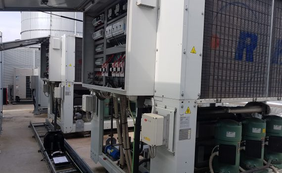 400 kw white chillers with panels open during air cooled chiller maintenance