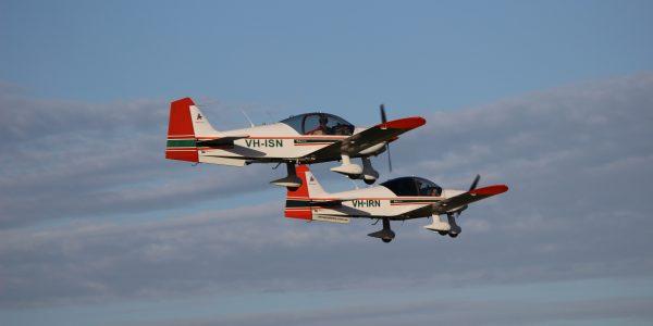 AAA Robin 2160 flight training aircraft in formation