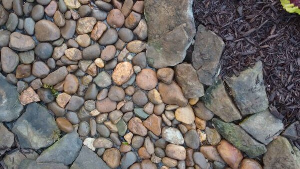 how to build a dry creek bed for drainage or aesthetics.