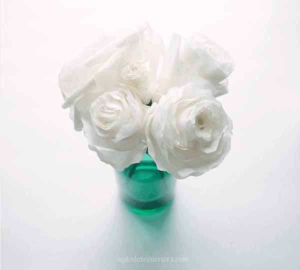 coffee filter flowers in a green vase with white background