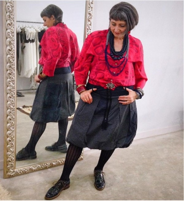 Black skirt, red blouse, and black necklaces | 40plusstyle.com