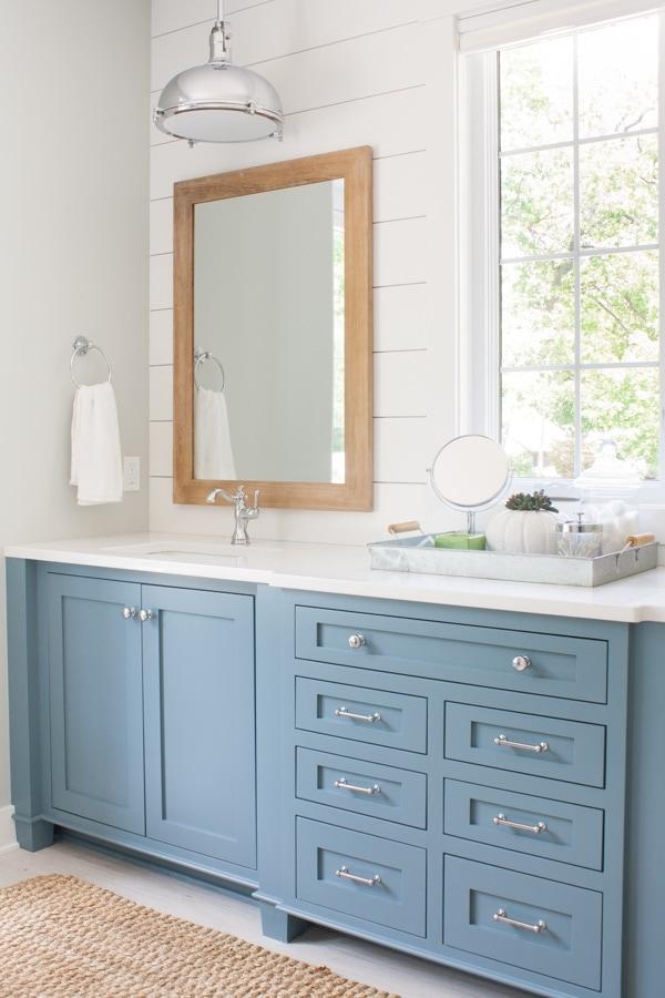 Lake house master bathroom blue cabinetry