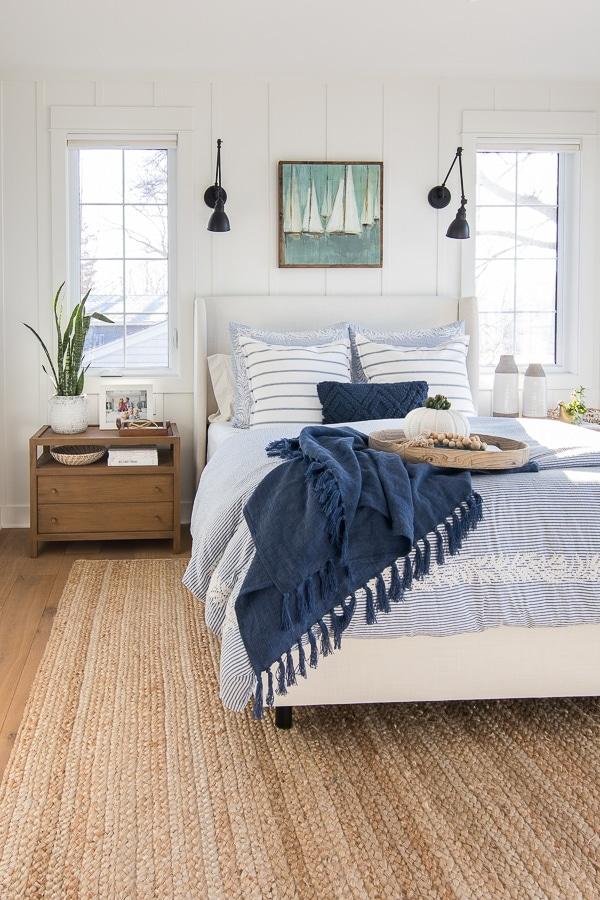 wood nightstand white upholstered bed blue bedding master bedroom