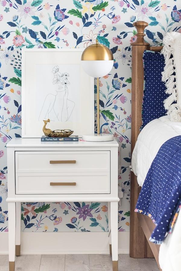 girls teen bedroom floral wallpaper white and brass nightstands