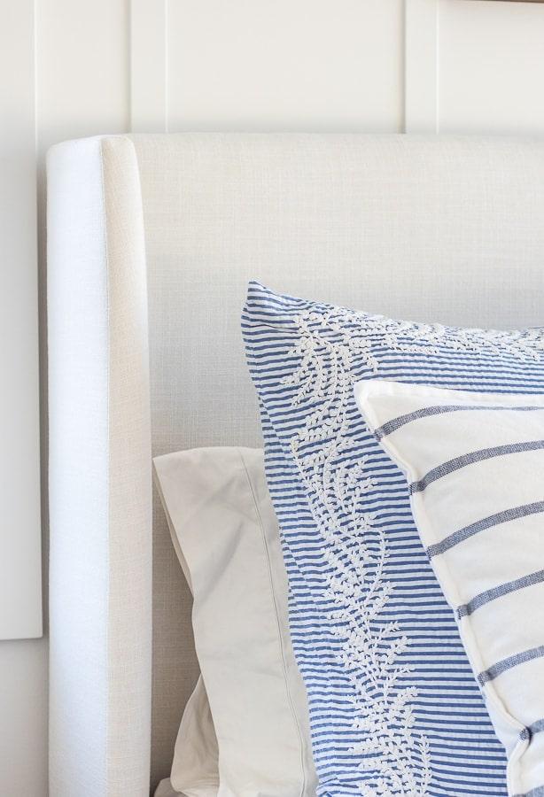 white linen upholstered bed