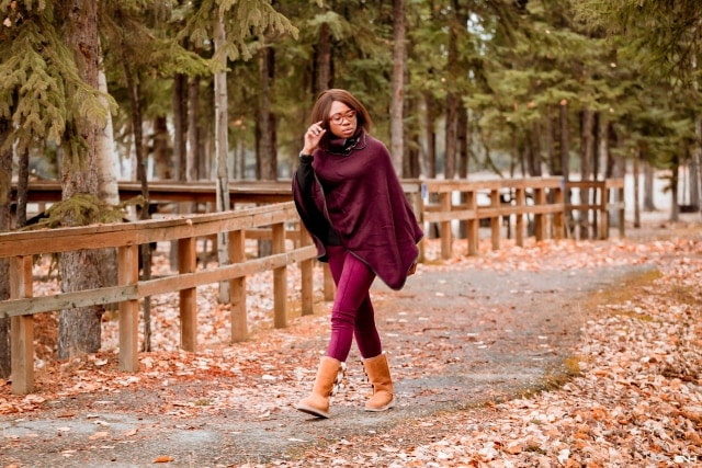 A winter outfit pairing a cowl neck poncho layered over an insulated fleecewear and super chic and comfortable burgundy faux suede leggings and the coziest Koolaburra by UGG boots. This is a practical and fashionable look that can be worn and remixed with other wardrobe essentials while keeping you warm on cold weather days. This post is all about winter fashion, fall fashion, New Jersey fashion blogger, black style blogger.