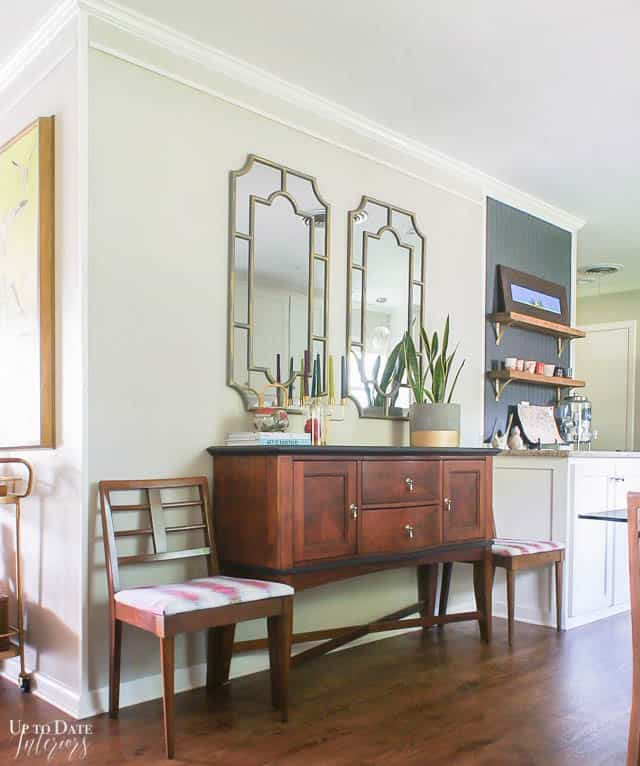 two-gold-mirrors-above-dining china cabinet-buffet