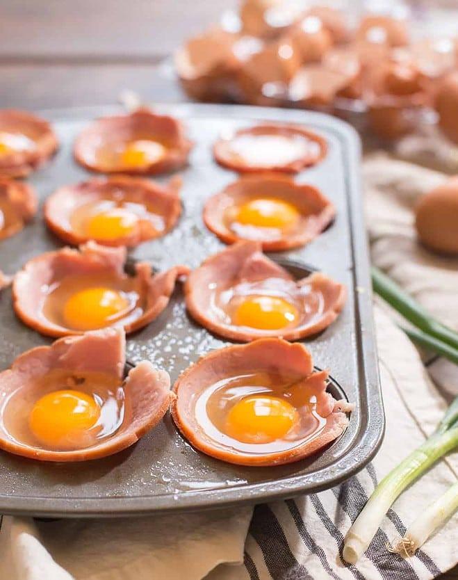 Raw Eggs in ham cups in a muffin tin