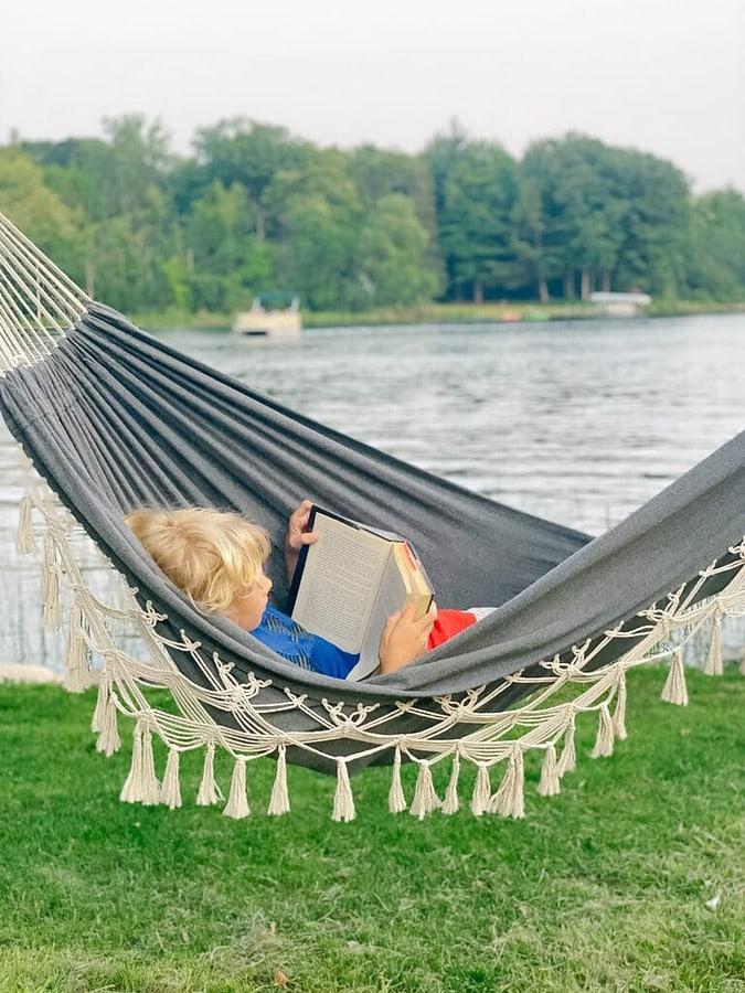 gray and white tasseled hammock
