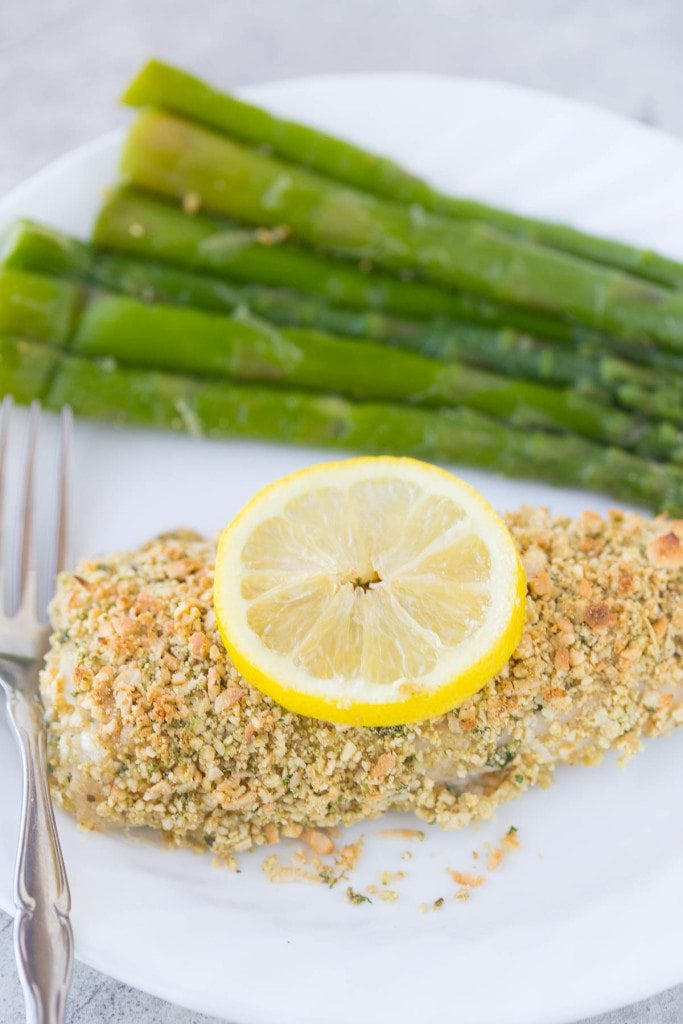 Paleo Coconut Cashew Crusted Mahi Mahi is a quick, easy, and healthy dinner option that's ready in under 20 minutes! Serve it up with a side of fresh grilled asparagus and caramelized pineapple, and you'll feel like you were whisked away to the tropics.    www.slimpickinskitchen.com