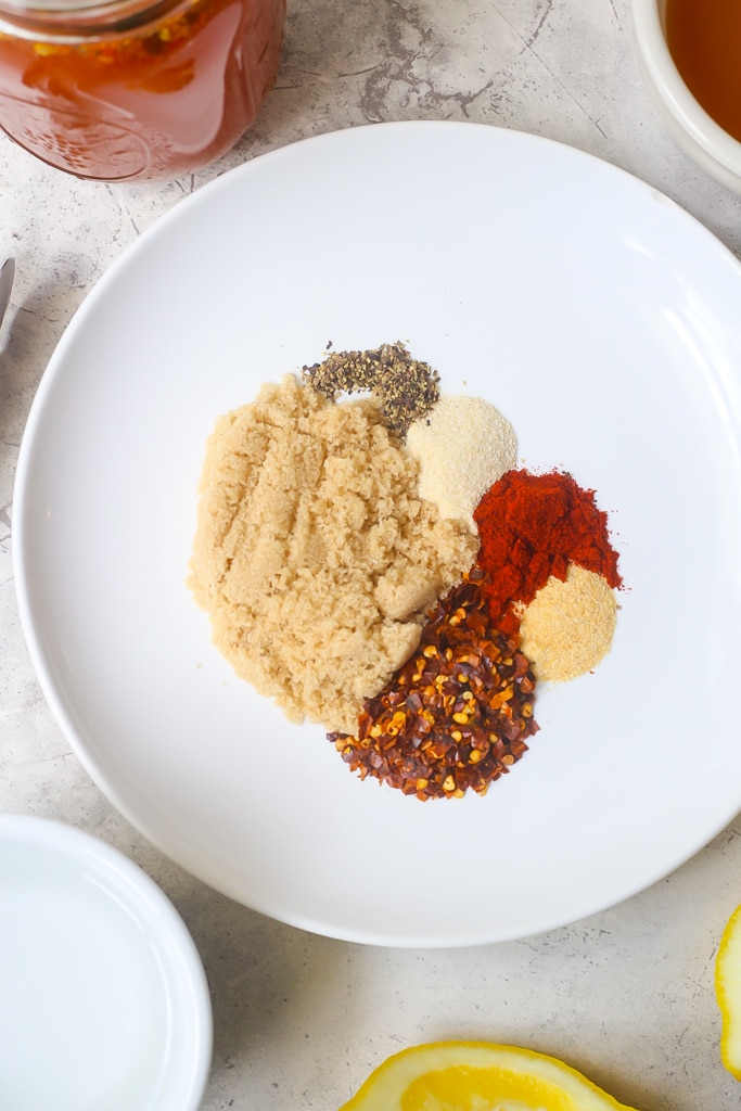 brown sugar and spices on a white plate to make vinegar based bbq sauce