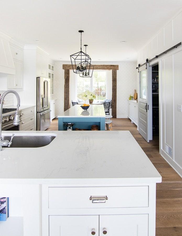 White and blue lake house kitchen