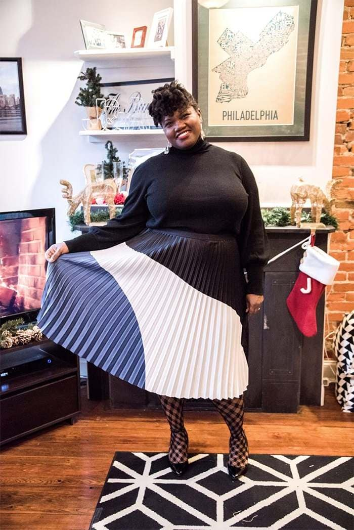 Georgette from Grown and Curvy Women is wearing Black Sweatshirt and Pleated Skirt   fashion over 40   40plusstyle