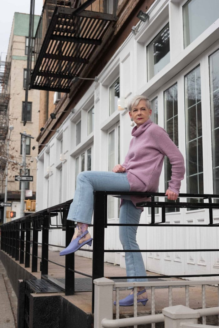 Accidental Icon Wearing Lavander Sweater and Jeans | 40plusstyle.com