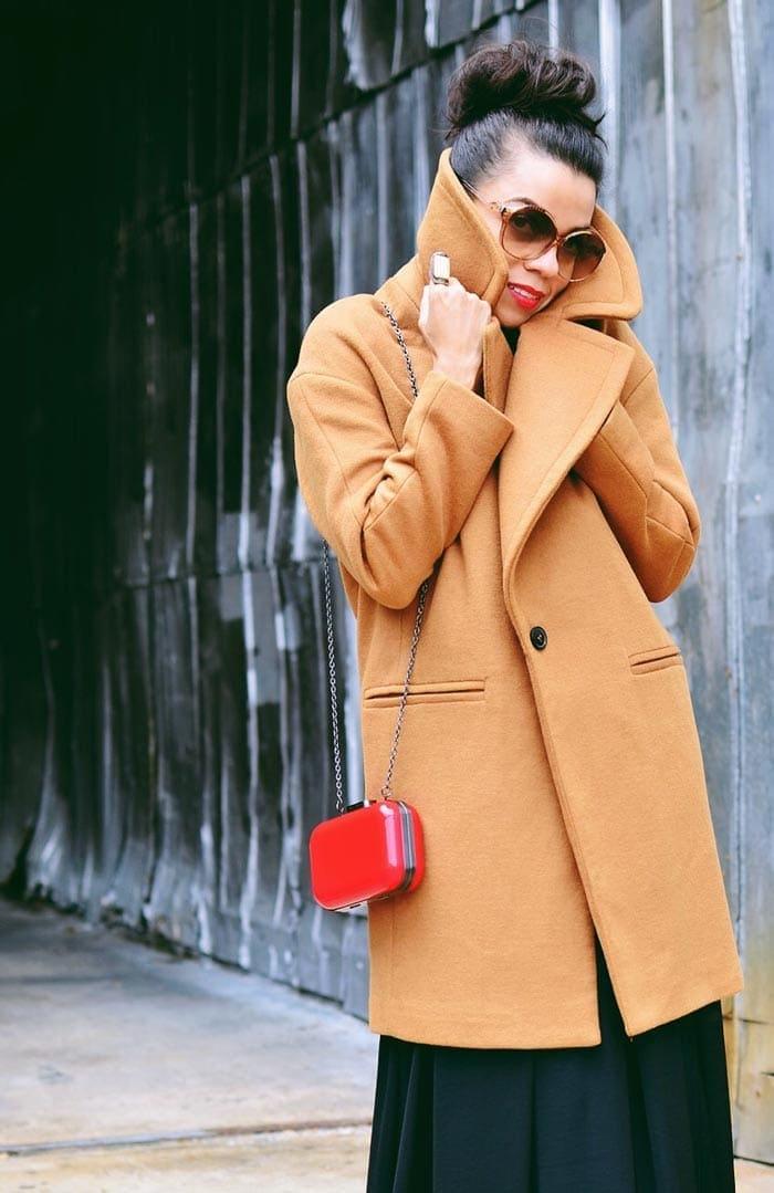 Carelia wearing a camel coat   40plusstyle.com