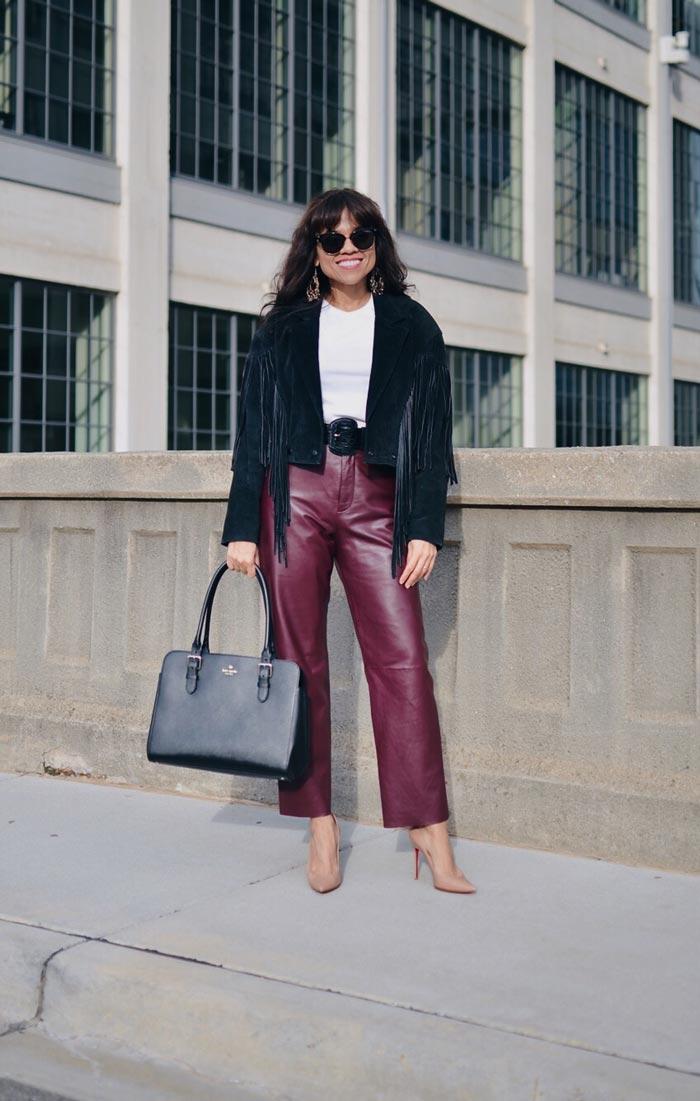 Carelia wearing leather pants and fringe jacket   40plusstyle.com