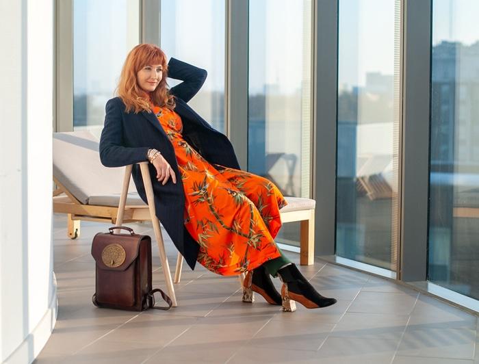 Catherine wearing orange printed dress and coat   40plusstyle.com