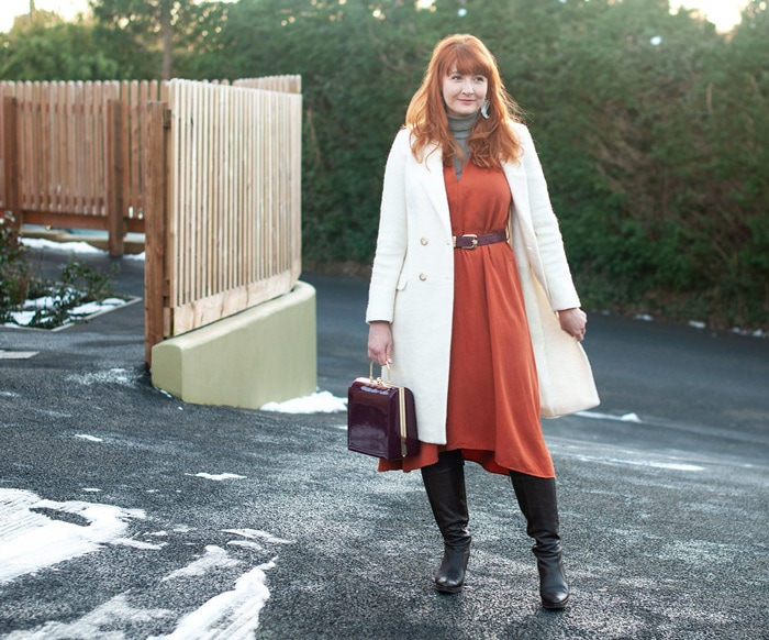Catherine wearing long white coat   40plusstyle.com