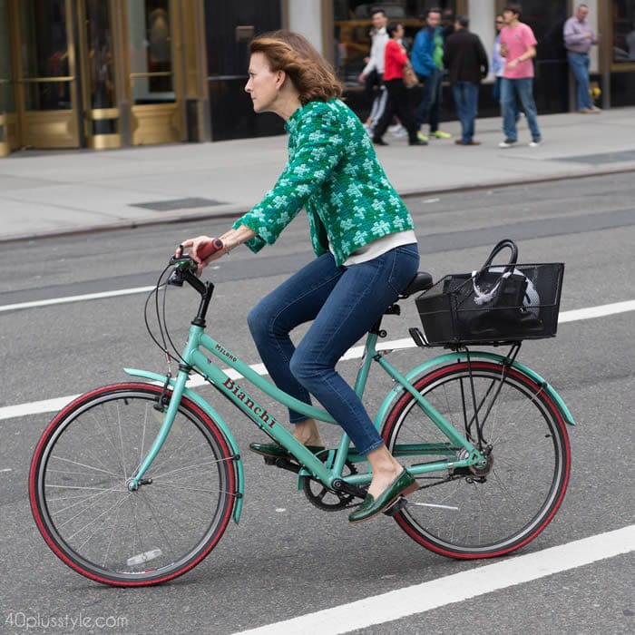 Getting noticed on a bike with a chic green jacket   40plusstyle.com