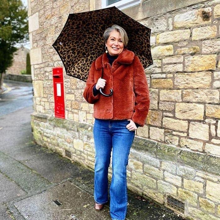 Rainy day outfits - Nikki carries an animal print umbrella | 40plusstyle.com