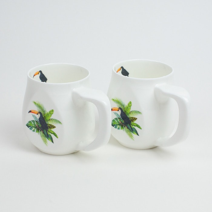 Two white fine bone china mugs with a colourful toucan printed on the side.