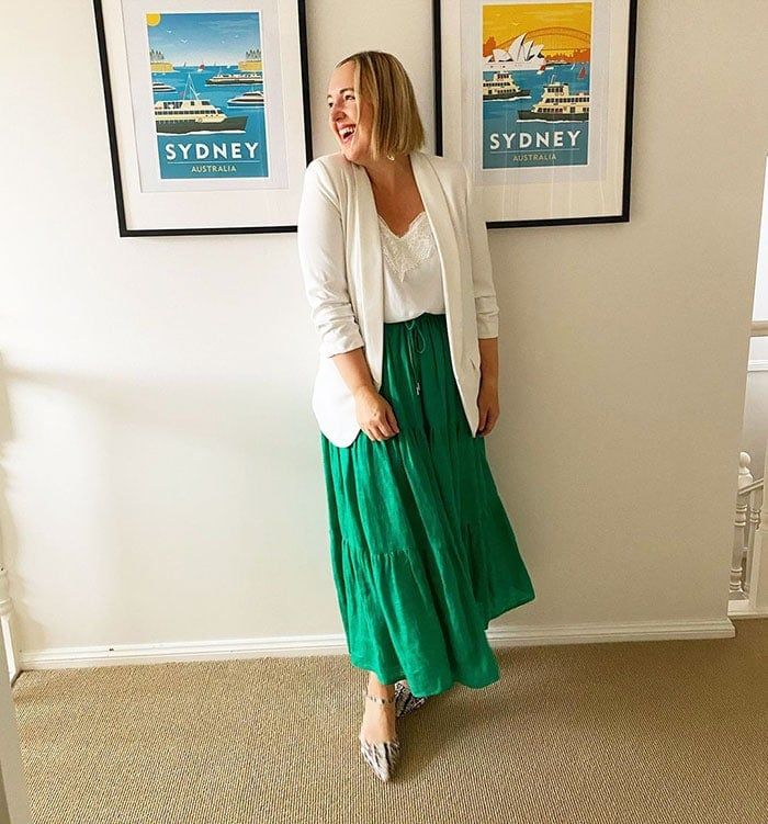 Kylie wears a white blazer and green skirt | 40plusstyle.com