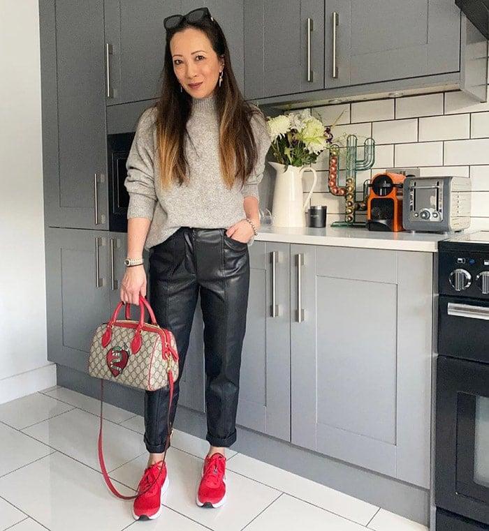 Abi wears black leather jeans | 40plusstyle.com