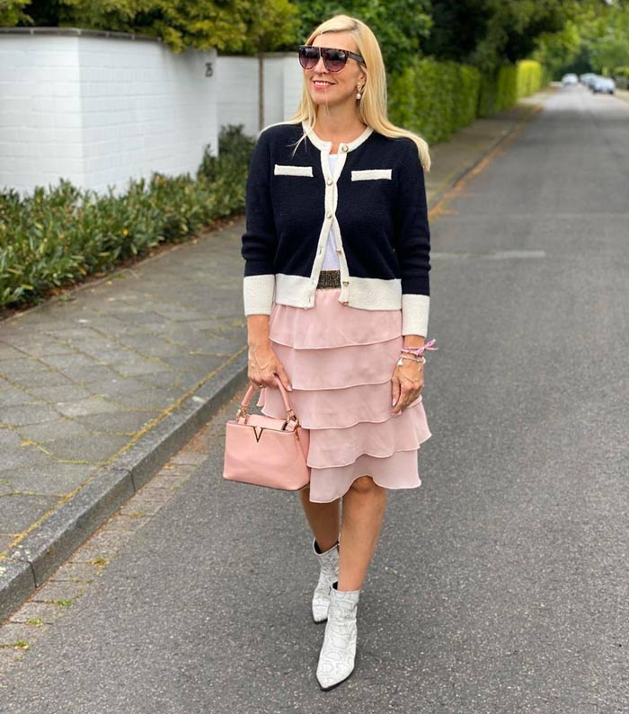 Preppy style: cardigan, skirt and booties | 40plusstyle.com