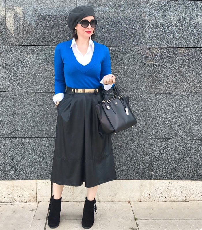 Layering a shirt and sweater worn with skirt and booties | 40plusstyle.com