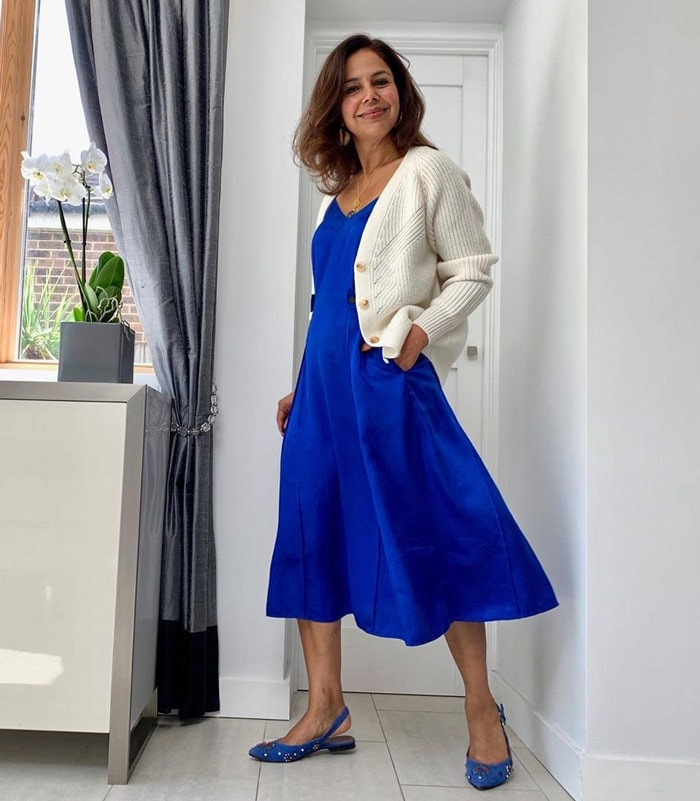 Anita wearing low heel party flats with her matching blue dress | 40plusstyle.com