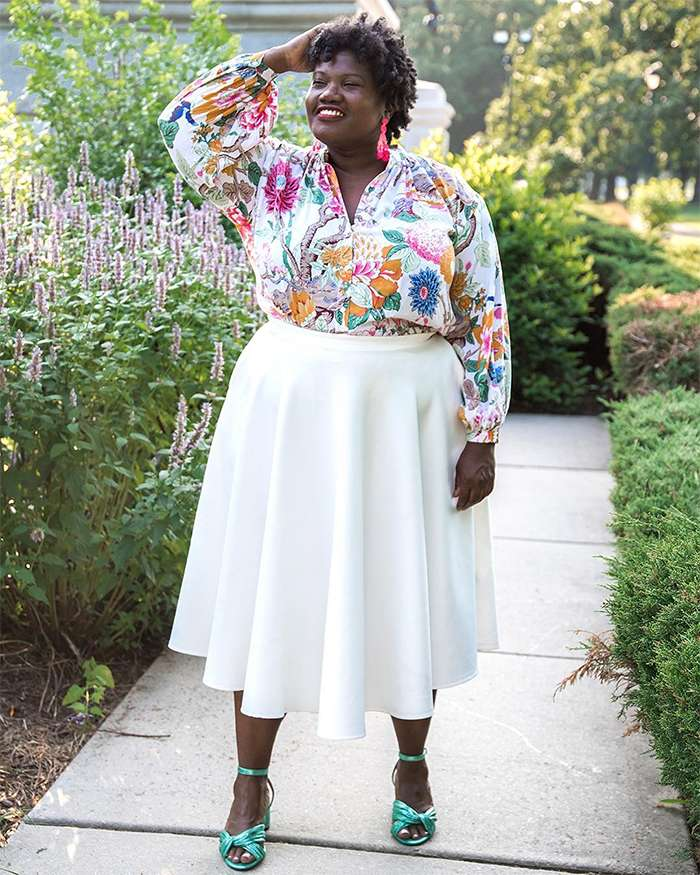 Georgette from Grown and Curvy Women is wearing Floral Long Sleeve Blouse with White Skirt and Green Strap Sandals   fashion over 40   40plusstyle