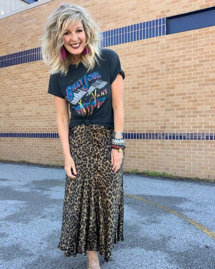 Graphic tee worn with skirt | 40plusstyle.com