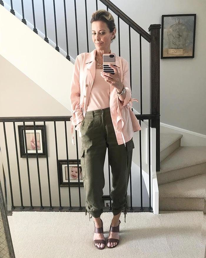 Susan wears cargo pants with a pink blazer   40plusstyle.com