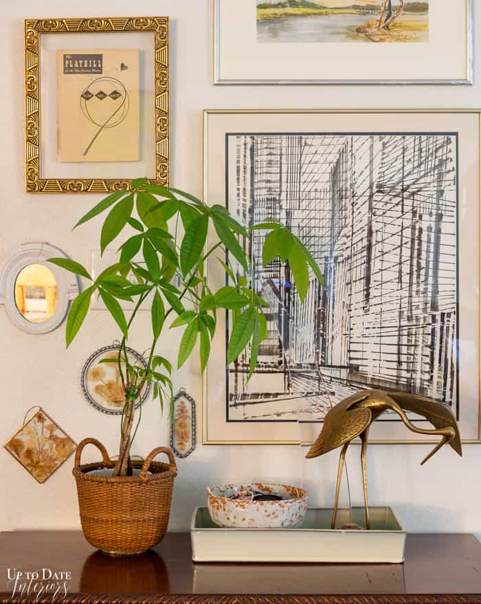 Brass crane and money plant with art