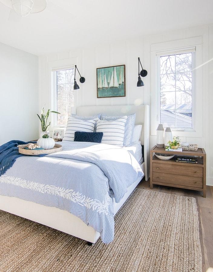 lake house bedroom white upholstered bed blue bedding