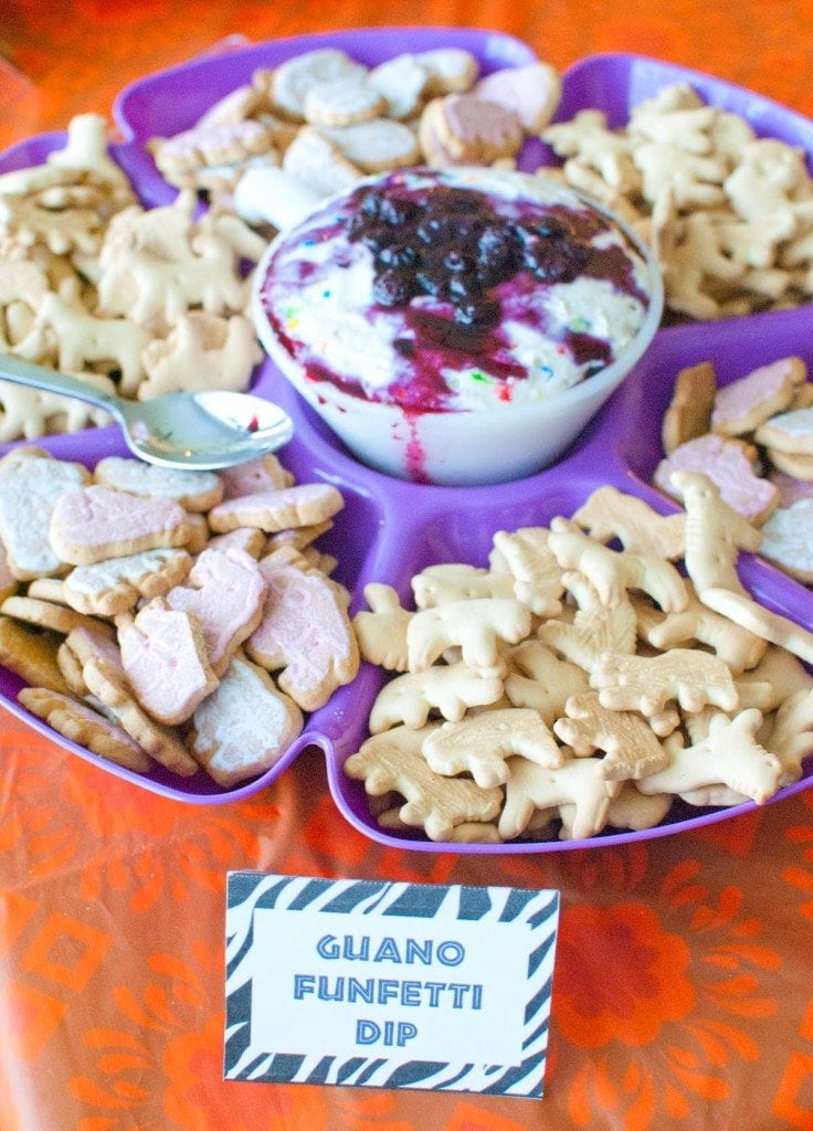 funfetti dip topped with blueberry pie filling served with animal crackers