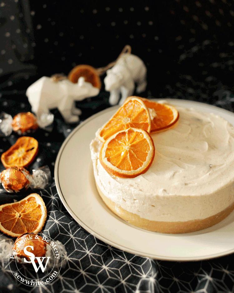 dried orange slices adorns the beautiful orange Christmas cheesecake