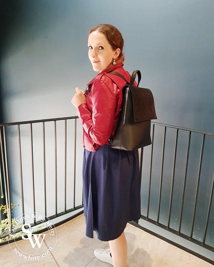 Sisley White wearing the black dahlia bag from Lawful London