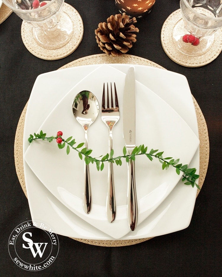 Viners Eden set cutlery in The Top 5 Lifestyle Gifts for Christmas on a white plate and gold placemat